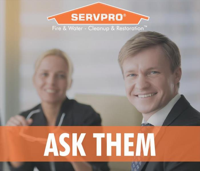 A businessman and a businesswoman smiling, Servpro logo, the phrase Ask Them