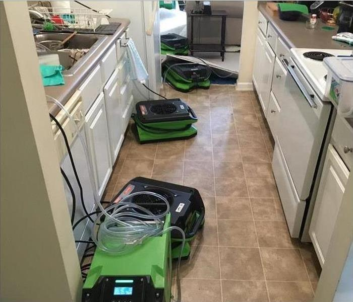 air movers placed on kitchen floor